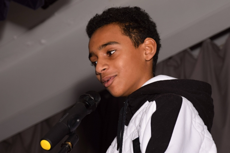 boy talking into a microphone
