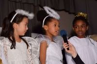 three girls dressed as angels in christmas play