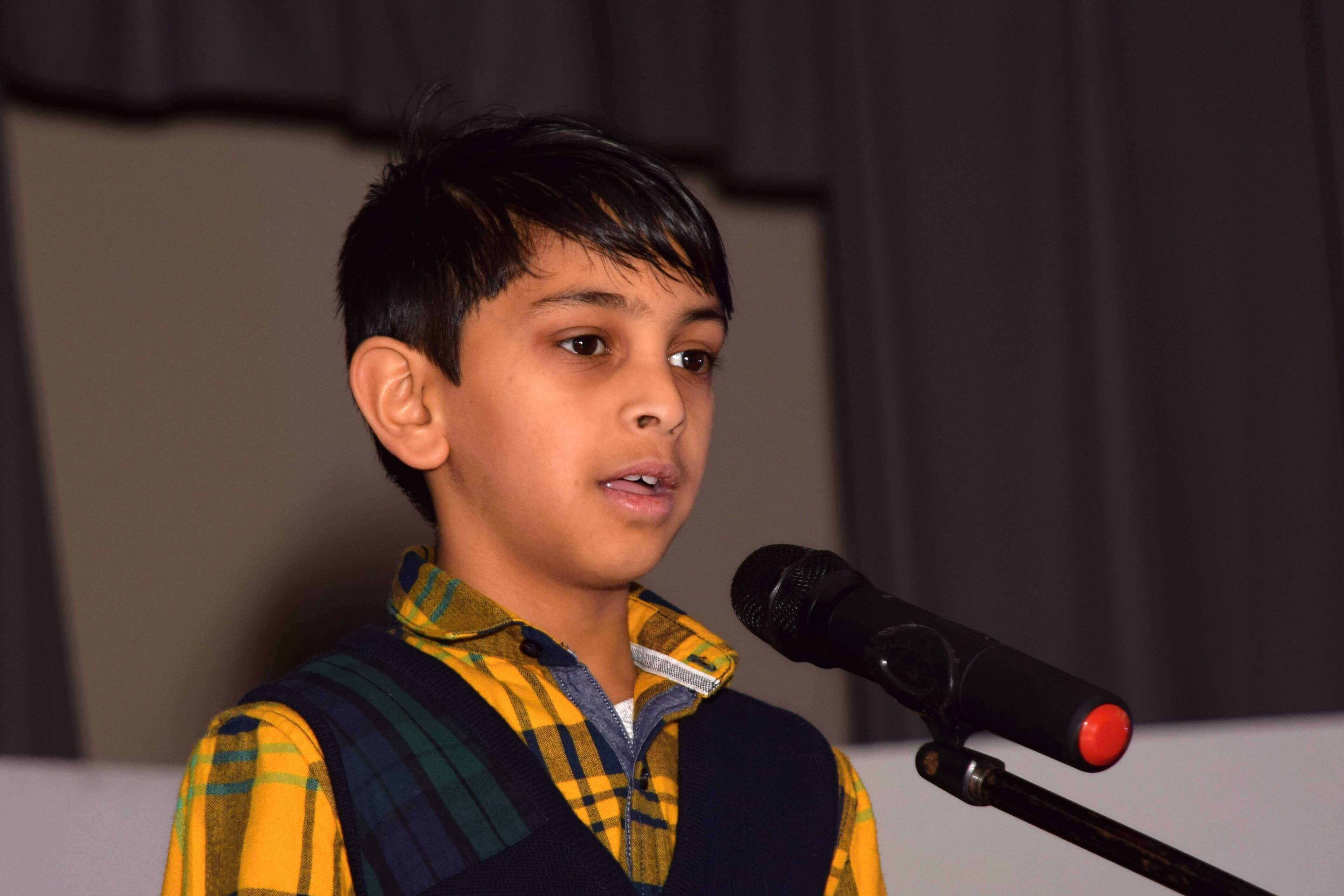 boy narrating on stage