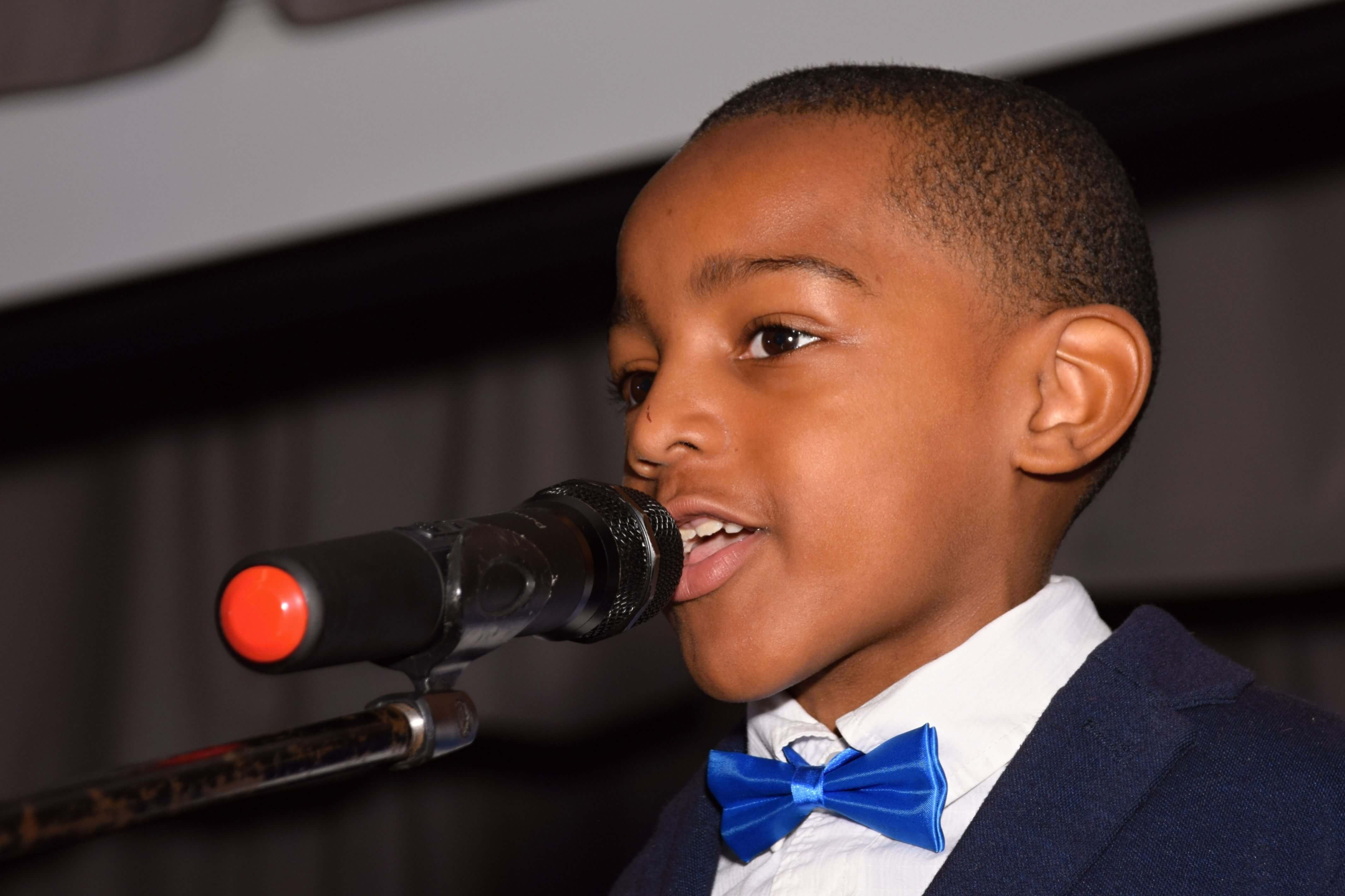 boy narrating with blue bow tie