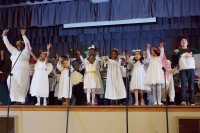group of children on singing and dancing on stage
