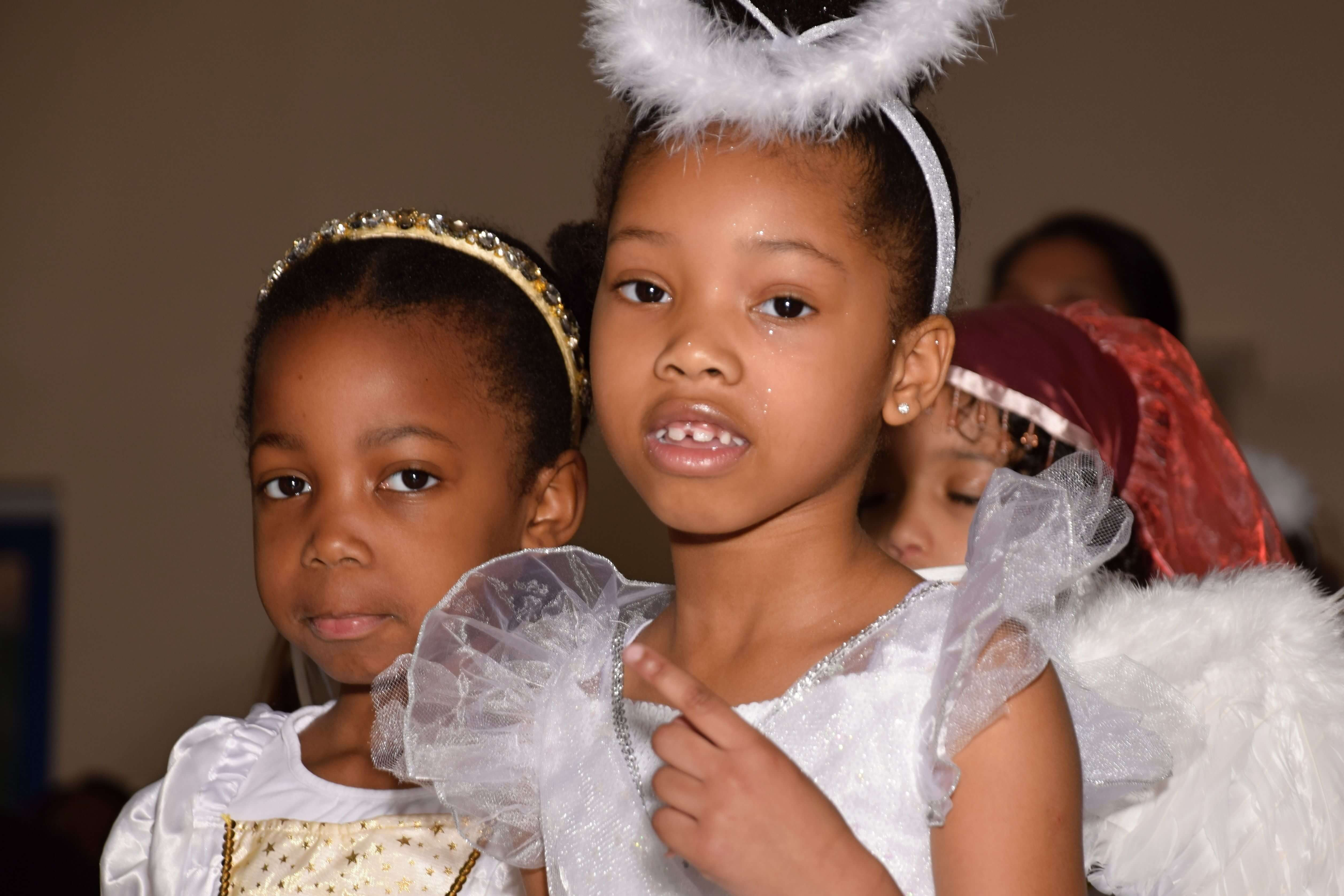 two girls dressed as angels in christmas play