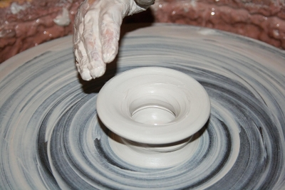 artisan forming clay