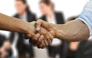 man woman shaking hands in agreement