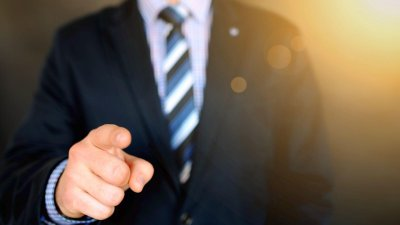 man in suit pointing finger